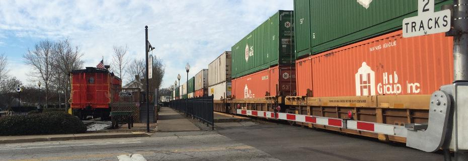 A double stack intermodal train passes the Caboose