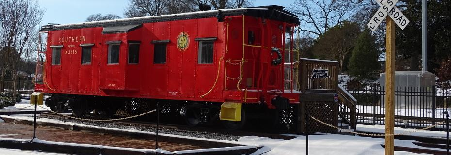 Caboose X-3115 with Christmas lights and wreaths and a dusting of snow on 1-7-2017