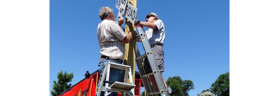 Chapter members install a cross-buck at the Museum complex