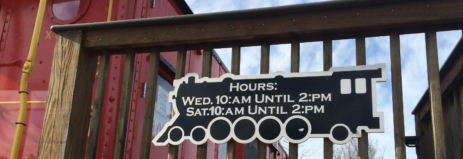 Museum Hours on display on the Caboose Deck