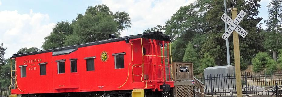 The new cross-buck takes its place next to Southern Caboose X-3115