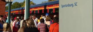 Passengers boarding the Amtrak excursion train on Oct. 30, 2016
